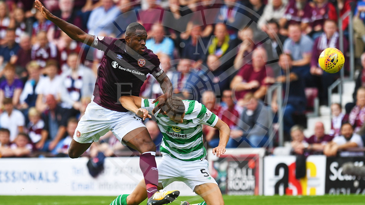 Uche Ikpeazu beats Jozo Simunovic to the ball