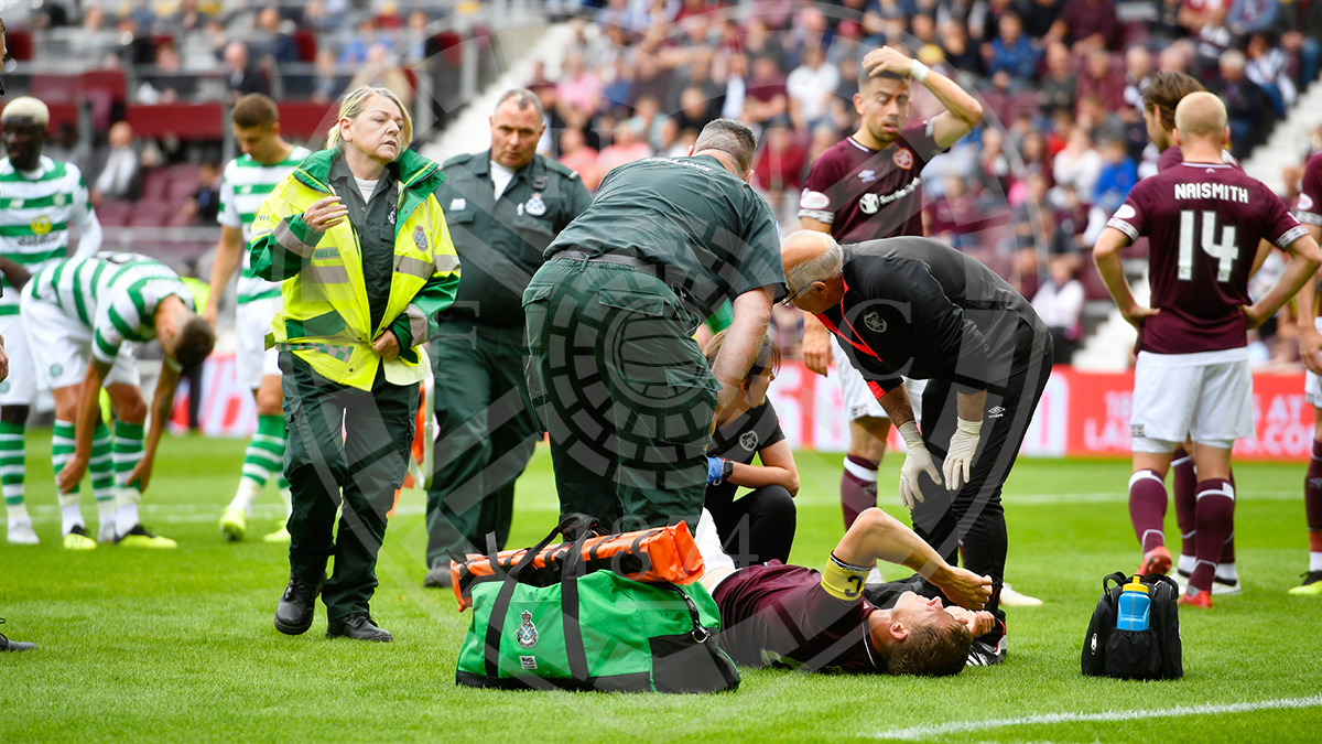 Christophe Berra is stretchered off injured