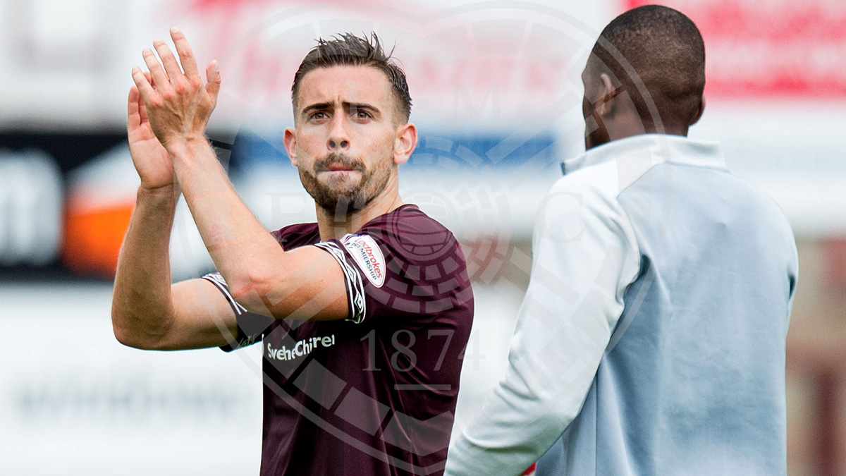 Matchwinner Olly Lee applauds the Hearts fans at full time