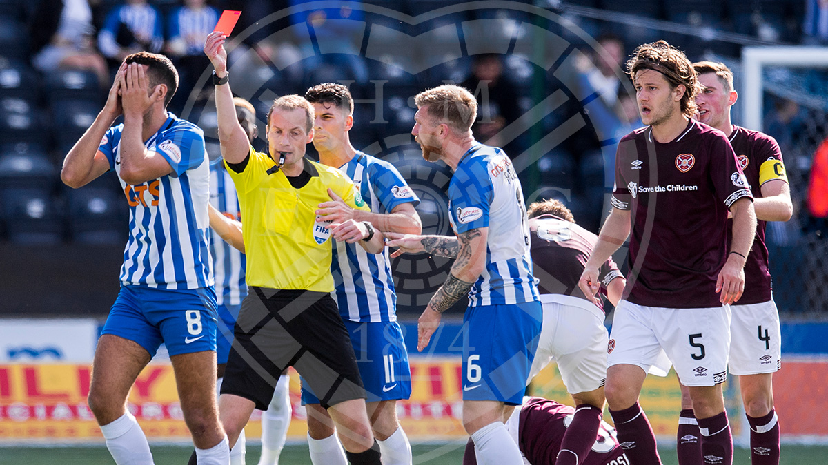 Gary Dicker receives a straight red